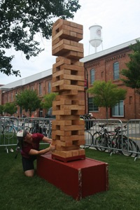 2012 06 23 A woman looks up at a human size jenga tower